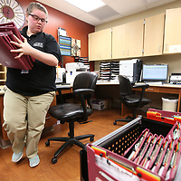 Julie Lyles, of Saltillo, works with patients files in the heart institute nurses station at the North Mississippi Medical Center on Monday morning in Tupelo. Lyles is in her second year as a teen volunteer at the Medical Center where the program allows her to serve and gain insight into health careers.