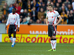 01.12.2013, KC Stadion, Hull, ENG, Premier League, Hull City Tigers vs FC Liverpool, 13. Runde, im Bild Liverpool's captain Steven Gerrard looks dejected as Hull City score the opening goal // during the English Premier League 13th round match between Hull City Tigers vs Liverpool FC at the KC Stadion in Hull, Great Britain on 2013/12/01. EXPA Pictures &copy; 2013, PhotoCredit: EXPA/ Propagandaphoto/ David Rawcliffe<br /> <br /> *****ATTENTION - OUT of ENG, GBR*****