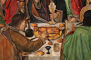 Last Supper, or Sant Sopar, detail of apostle taking some roasted meat, c. 1462-75, tempera and stucco relief with gold leaf, from the St Augustine Altarpiece, by Jaume Huguet, 1412-92, and Pau Vergos, in Gothic style, in the Museu Nacional d'Art de Catalunya, Barcelona, Spain. This is a panel from the altarpiece from the convent church of Sant Agusti Vell, Barcelona, commissioned by the Guild of Tanners. The MNAC holds 7 of the 8 surviving panels from this altarpiece. Picture by Manuel Cohen
