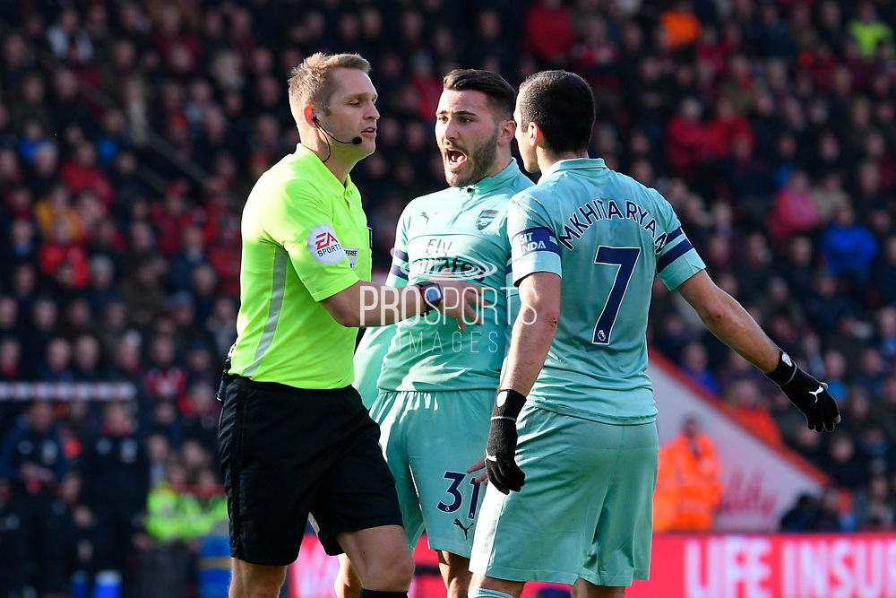 Sead Kolasinac (31) of Arsenal and Henrikh Mkhitaryan (7) of Arsenal protests to referee Craig Pawson during the Premier League match between Bournemouth and Arsenal at the Vitality Stadium, Bournemouth, England on 25 November 2018.