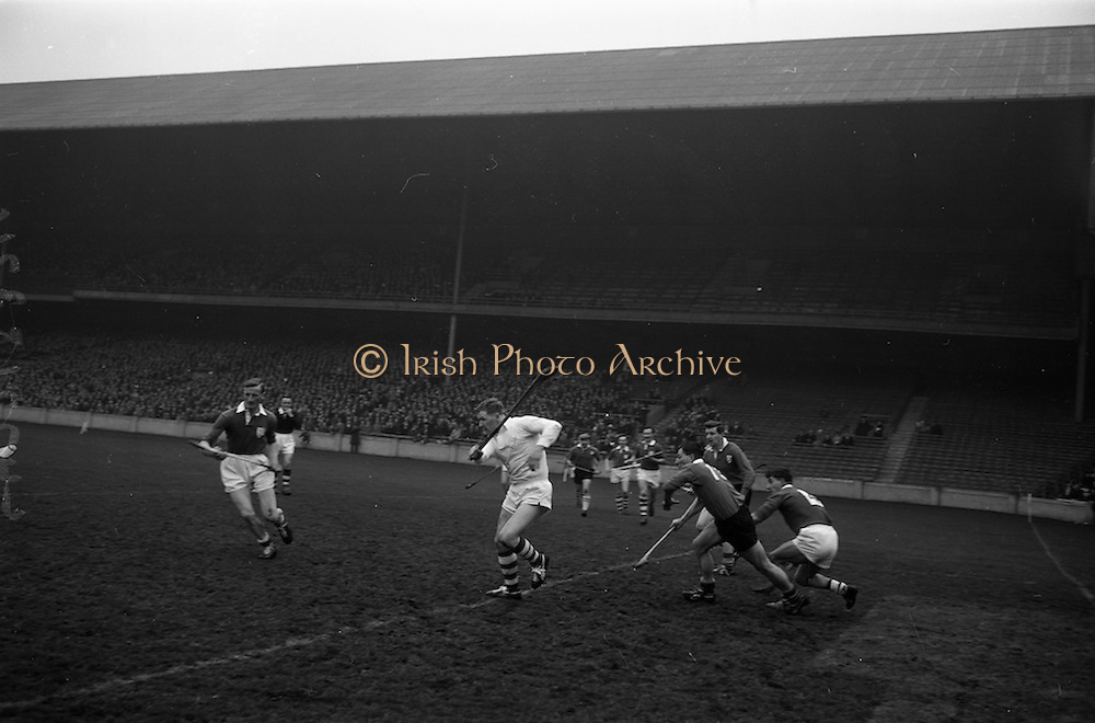 17/03/1965<br /> 03/17/1965<br /> 17 March 1965<br /> Railway Cup Hurling final  Munster v Leinster at Croke Park, Dublin. Ollie Walsh, Leinster keeper, clears along the ground. J. Bennet (3rd from left) Munster and E. Colfer Leinster (left) right behind him.