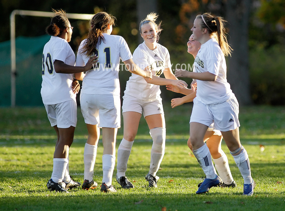 Beacon, New York - Beacon High School players celebrate after scoring a goal against Sleepy Hollow High School in a Section One Class A girls' soccer playoff game on Oct. 28, 2010. ©Tom Bushey / The Image Works