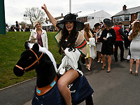 National Hunt Horse Racing - 2019 Randox Health Grand National Festival - Friday, Day Two (Ladies Day)<br /> <br /> Female racegoers on a windy  Ladies Day<br /> at Aintree Racecourse.<br /> <br /> COLORSPORT/WINSTON BYNORTH