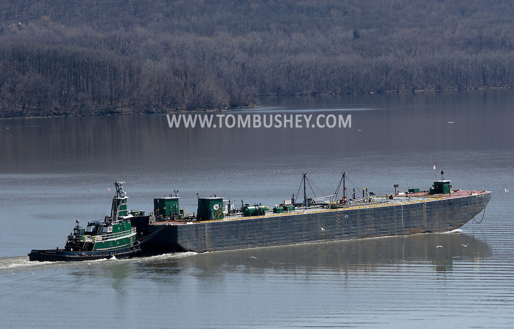Newburgh, New York - The tugboat King Philip pushes a barge down the Hudson River on March 17, 2010.