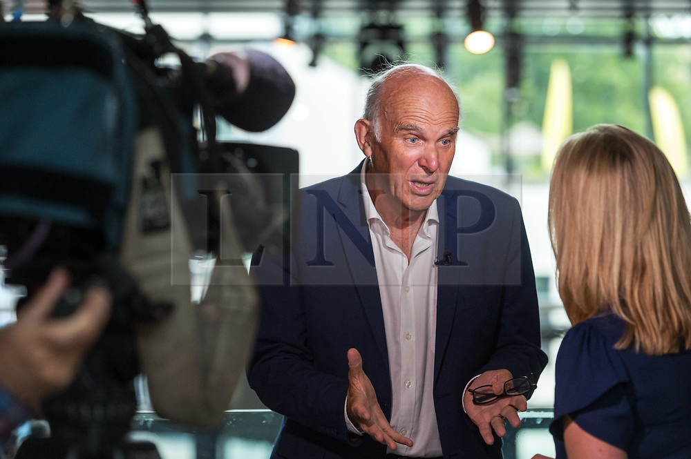 © Licensed to London News Pictures. 11/08/2018. Bristol, UK. SIR VINCE CABLE, Lib Dem leader, speaking to the media at a People's Vote rally at the Colston Hall in Bristol calling for a people's vote on the Brexit deal. Speakers at the rally included Leader of the Liberal Democrats Sir Vince Cable, Totnes Conservative MP Sarah Wollaston and Labour MP Stephen Doughty. The Bristol rally is the first in a series of rallies across the UK. Photo credit: Simon Chapman/LNP