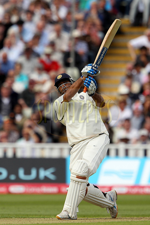 MS Dhoni knocks Tim Bresnan for six during day one of the third test match between England and India held at Edgbaston Cricket ground in Birmingham on the 10th August 2011...Photo by Ron Gaunt/SPORTZPICS/BCCI
