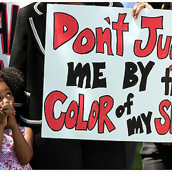 Four year-old Korynn Kinlaw listens as her mother hotel worker Dionne Kinlaw speaks during a protest for African American and Latino hotel workers about alleged discrimination at the Ritz-Carlton Huntington Hotel Wednesday, Aug. 8. 2007 in Pasadena.