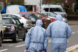 © Licensed to London News Pictures. 19/09/2013. London, UK. Police forensic officers are seen at the scene of a shooting on Coppock Close in Battersea London today (19/09/2013). Taking place at around 8pm last night a 19 year old male was pronounced dead at around 9pm. Photo credit: Matt Cetti-Roberts/LNP