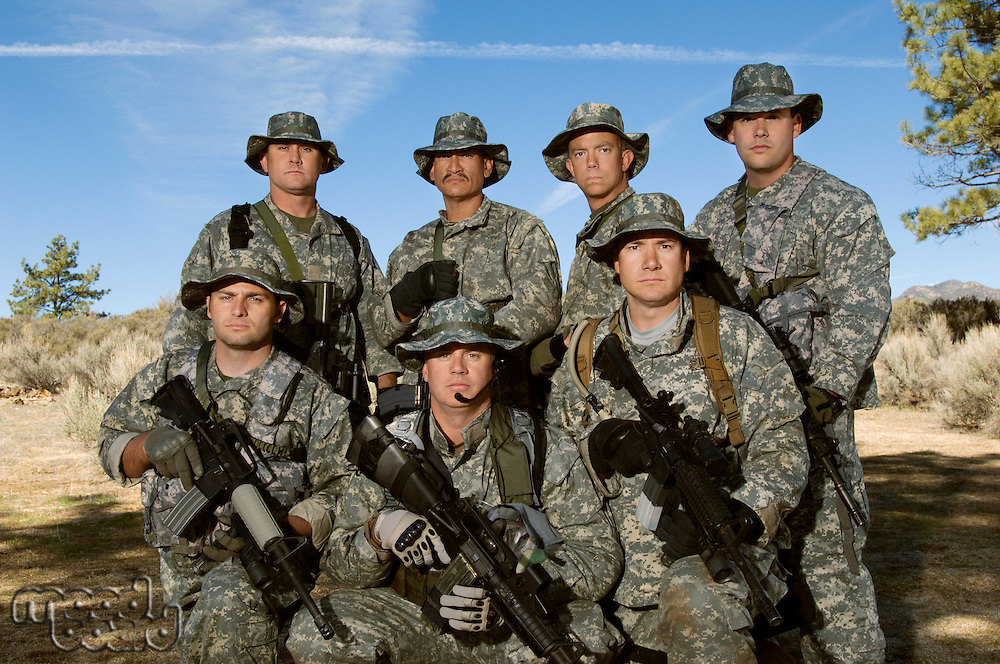 Group portrait of soldiers on field