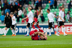 Players of Germany celebrate victory and sadness by Gracjan Horoszkiewicz of Poland during the UEFA European Under-17 Championship Group A semifinal match between Germany and Poland on May 13, 2012 in SRC Stozice, Ljubljana, Slovenia. Germany defeated Poland 1:0. (Photo by Matic Klansek Velej / Sportida.com)