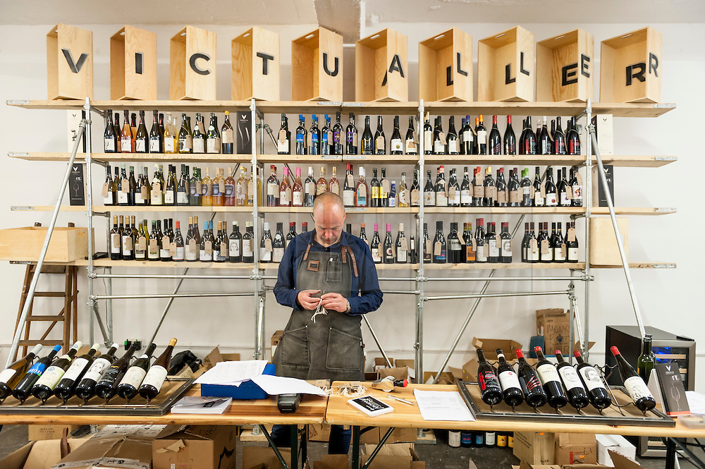 © Licensed to London News Pictures. 16/05/2016. London, UK. The victualler takes bulk orders from buyers.  Buyers and wine lovers visit the Raw Wine Fair at the Old Truman Brewery near Brick Lane.  The fair brings over 180 artisan growers and wine makers from around the world who specialise in producing organic, biodynamic and naturally made wines with minimal additives. Photo credit : Stephen Chung/LNP