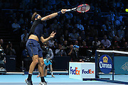 Roger Federer with a smash at the net during the final of the ATP World Tour Finals between Roger Federer of Switzerland and Novak Djokovic at the O2 Arena, London, United Kingdom on 22 November 2015. Photo by Phil Duncan.