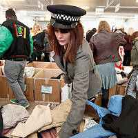 LONDON, ENGLAND - FEBRUARY 06:  Shoppers at Angels Retro Sale on February 6, 2010 in London, England. Angels Costumiers are selling over 25,000 items of clothing and accessories from their warehouse in Wembley on February 6, 2010. The Retro Sale features fashion items from the 1950s to the 1990s as well as period military uniforms. Angels is the world's longest-established supplier of costumes to film and theatre, founded in 1840 the company supplies costumes to over 1000 productions per year.  (Photo by Marco Secchi/Getty Images)