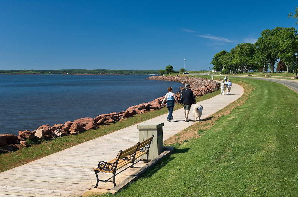 People walking on waterfront pathway in Victoria Park, Charlottetown; Prince Edward Island, Canada.