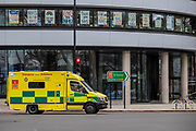 An ambulance with lights flashing heads past messages of support for the NHS in the window of a building opposite St Thomas' Hospital, London - The 'lockdown' continues for the Coronavirus (Covid 19) outbreak in London.
