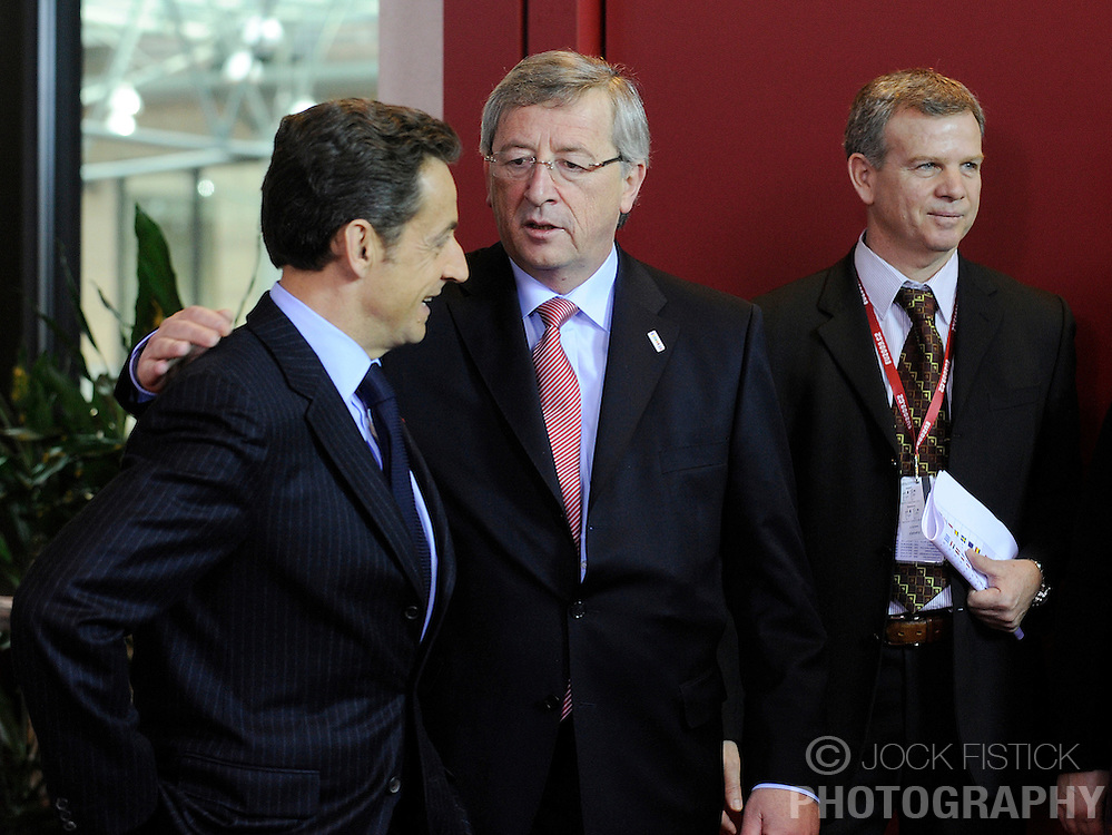 Nicolas Sarkozy, France's president, left, speaks with Jean-Claude Juncker, Luxembourg's prime minister, during the European Union summit at EU headquarters in Brussels, Belgium, on Sunday, March. 1, 2009. .(Photo © Jock Fistick)