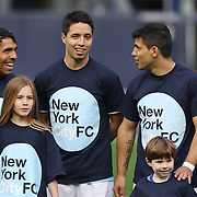 Manchester City players including Carlos Tevez, (left) Samir Nasri (centre)  and Sergio Aguero wearing New York City FC shirts accompanied by children on the pitch before the Manchester City V Chelsea friendly exhibition match at Yankee Stadium, The Bronx, New York. Manchester City won the match 5-3. New York. USA. 25th May 2012. Photo Tim Clayton