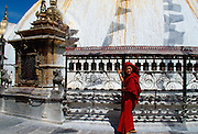 Buddhist worshipper with prayer wheels at Swayambhunath Stupa, Kathmandu Valley, Nepal.