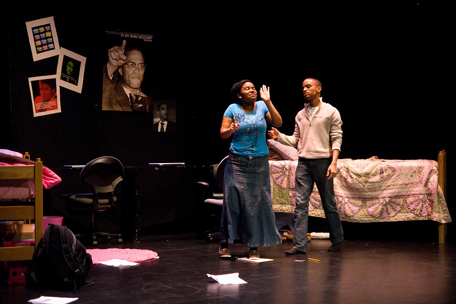 """LEST WE FORGET -- """"Marie"""" (left, played by Crystal Robinson) and """"Mike"""" (Joshua Bridges), students from Washington University in St. Louis, perform a scenes from Black Anthology 2012 """"Lest We Forget"""" at Edison Theatre on the Danforth Campus in St. Louis Friday, Feb. 3, 2012. Photo by Sid Hastings © copyright 2012 Washington University in St. Louis."""