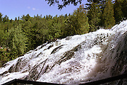 This view of Upper Michigan's impressive Bond Falls, midway up on the western side, is my favorite. From this observation point, you can actually reach out and touch the falls.