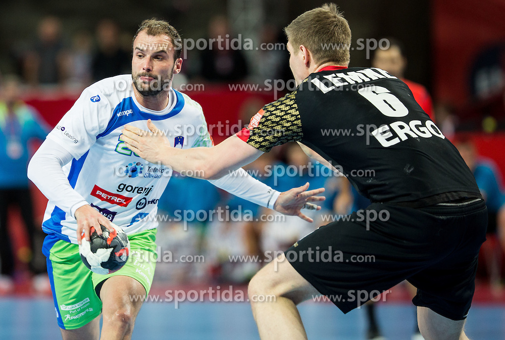 Uros Zorman of Slovenia vs Finn Lemke of Germany during handball match between National teams of Germany and Slovenia on Day 6 in Preliminary Round of Men's EHF EURO 2016, on January 20, 2016 in Centennial Hall, Wroclaw, Poland. Photo by Vid Ponikvar / Sportida