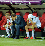Marco Reus, Manager Oliver Bierhoff and Thomas Müller come to terms with losing their UEFA EURO 2012 semi final match between Germany and Italy at the National Stadium on June 28, 2012 in Warsaw, Poland.