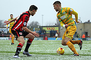 Morecambe Striker Shaun Miller abd Yeovil Defender Yakub Sokolik during the Sky Bet League 2 match between Morecambe and Yeovil Town at the Globe Arena, Morecambe, England on 16 January 2016. Photo by Pete Burns.
