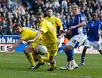 Photo: Steve Bond/Richard Lane Photography. Leicester City v Cardiff City. Coca Cola Championship. 13/03/2010. Adam Matthews (C) clears in front of Martyn Waghorn