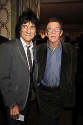 Left to right, RONNIE WOOD and JOHN HURT at the 2009 South Bank Show Awards held at The Dorchester, Park Lane, London on 20th January 2009.