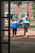 Vice President for Student Affairs Ryan Lombardi (Left) and President Roderick McDavis help first year students move into their residence halls. Photo by Ben Siegel