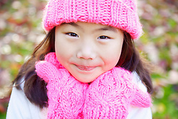 Close up Portrait of Young Girl Wearing Pink Hat and Gloves