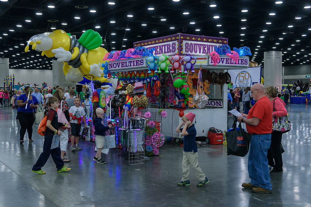 Visitors walk among the float and inflatables at the 2017 Kentucky Derby Festival Republic Bank Pegasus Parade Preview Party, Tuesday, May 2, 2017 at the Kentucky Exposition Center in South Wing C in Louisville, Ky. (Photo by Brian Bohannon)