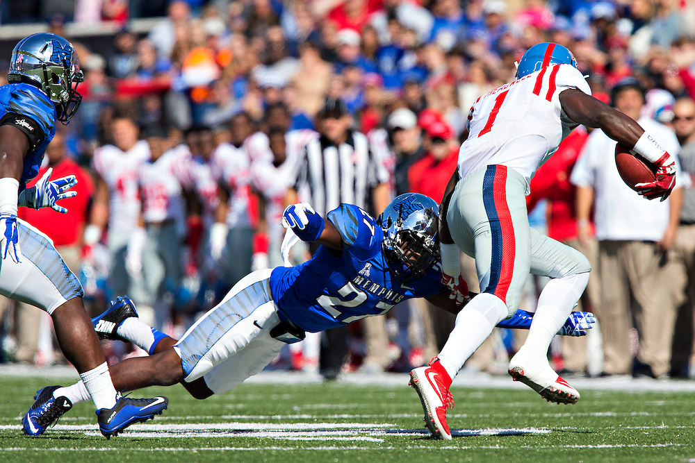 MEMPHIS, TN - OCTOBER 17:  Dion Witty #27 of the Memphis Tigers dives to tackle Laquon Treadwell #1 of the Ole Miss Rebels at Liberty Bowl Memorial Stadium on October 17, 2015 in Memphis, Tennessee.  The Tigers defeated the Rebels 37-24.  (Photo by Wesley Hitt/Getty Images) *** Local Caption *** Dion Witty; Laquon Treadwell