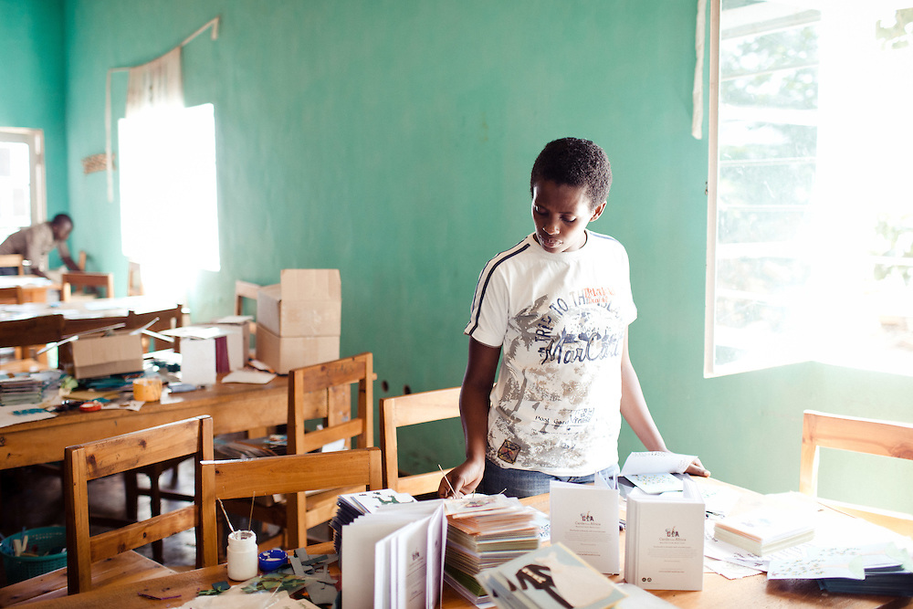 Mutesi Jennette, 25 years old, car maker at Cards from Africa. Her Father dies in 1994 folllowed by her mother in 1998, both of HIV. She was 13 when she became an orphan.