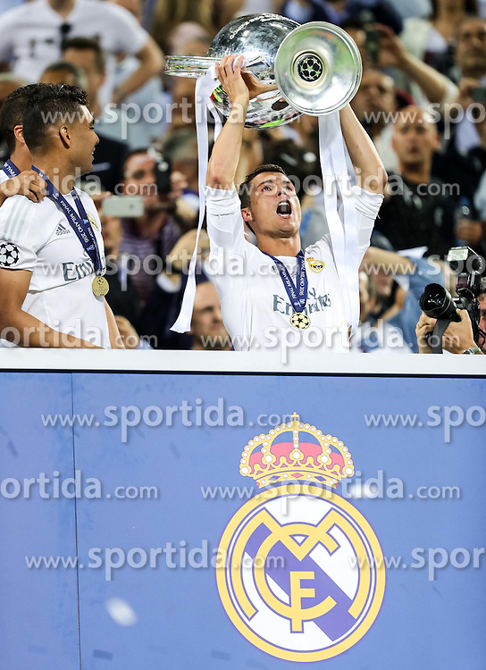 Cristiano Ronaldo of Real Madrid celebrates with a Trophy during Trophy ceremony after winning during the football match between Real Madrid (ESP) and Atlético de Madrid (ESP) in Final of UEFA Champions League 2016, on May 28, 2016 in San Siro Stadium, Milan, Italy. Photo by Vid Ponikvar / Sportida