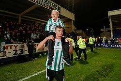 Young Blyth Spartans mascot Cory Davison is held on the shoulders of Alex Nicholson as the pair celebrate after their side win 1-2 to progress to the next round of hte FA CUP - Photo mandatory by-line: Rogan Thomson/JMP - 07966 386802 - 05/12/2014 - SPORT - FOOTBALL - Hartlepool, England - Victoria Park - Hartlepool United v Blyth Spartans - FA Cup Second Round Proper.