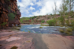Tourists visit Camp Creek in the Kimberley wet season