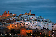 "Ostuni, the old town. On the top of the hill the Purgatorio church (left) and the cathedral (right). The so-called ""Old Town"" is Ostuni's citadel built on top of a hill and still fortified by the ancient walls. Ostuni is regarded as an architectural jewel, and is commonly referred to as ""the White Town"" (""La Città Bianca"", in Italian) for its white walls and its typically white-painted architecture."