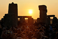 © Licensed to London News Pictures. 21/06/2014; Amesbury, WIltshire, UK.  Thousands of people welcome the solstice on the longest day at Stonehenge.<br /> Photo credit: Simon Chapman/LNP