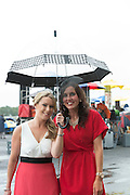 01/08/2014 Sheila Hession Claregalway and Eva Long Creggmore at a very wet Galway race track in Ballybrit.   .Photo:Andrew Downes