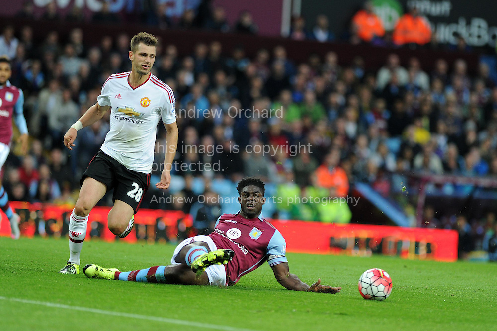Micah Richards of Aston Villa &reg; slides in to deny Morgan Schneiderlin of Manchester Utd. Barclays Premier League match, Aston Villa v Manchester Utd at Villa Park in Birmingham, Midlands on Friday 14th August  2015.<br /> pic by Andrew Orchard, Andrew Orchard sports photography.