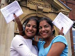 Twin Sisters (left to right) Sheena and Reena Sodha from Chelmsford County High School for Girls, both got 3 A's from their A-Level results. August 18, 2000. Photo by Andrew Parsons/i-Images..
