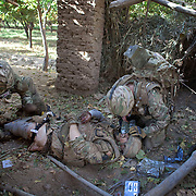 Private Stephen Bainbridge, aged 25, from Kirkcaldy a soldier with 3 SCOTS (The Black Watch) lays gravely wounded in a compound after an IED explosion which traumatically amputated his right leg and damaged his right so badly that it too later had to be amputated. His life was saved by the swift actions of Cpl John Goodie (21) a medic with 1 PWRR (The Princess of Wales's Royal Regiment) who applied tourniquets and first field dressings to get the bleeding under control. Private Chis Watson (21) also assisted in the treatment whilst reassuring the casualty and keeping him alert and responsive.  Once he had been stabilized the men CASEVAC'd Private Bainbridge to the MERT helicopter and he was rushed to Bastion Field Hospital.  Loya Manda, Nad e Ali, Helmand Province, Afghanistan on the 11th of November 2011.