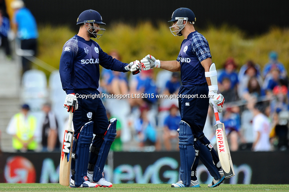 Scotland player L-R Preston Mommsen and Kyle Coetzer during their record batting partnership for Scotland during the 2015 ICC Cricket World Cup match between Bangladesh v Scotland. Saxton Oval, Nelson, New Zealand. Thursday 5 March 2015. Copyright Photo: Chris Symes / www.photosport.co.nz