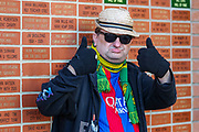 A Norwich fan arrives at the ground ahead of the Premier League match between Norwich City and Manchester United at Carrow Road, Norwich, England on 27 October 2019.