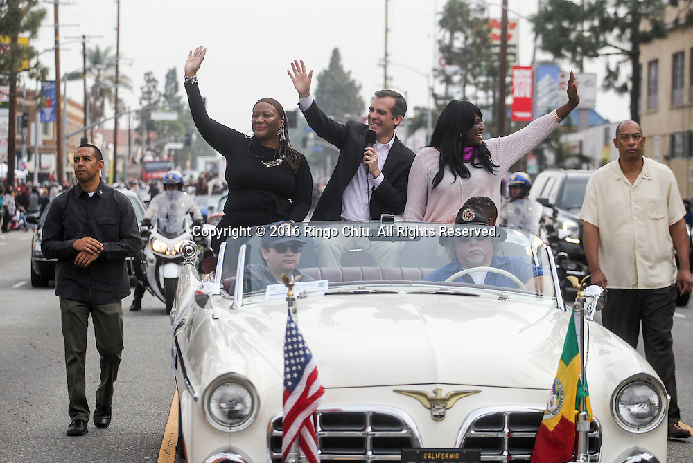 Los Angeles Mayor Eric Garcetti, center, waves during during the Martin Luther King Jr. parade in Los Angeles on Monday Jan. 18, 2016. The 31st annual Kingdom Day Parade honoring Martin Luther King Jr. was themed &quot;Our Work Is Not Yet Done&quot;(Photo by Ringo Chiu/PHOTOFORMULA.com)<br /> <br /> Usage Notes: This content is intended for editorial use only. For other uses, additional clearances may be required.