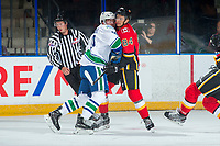 PENTICTON, CANADA - SEPTEMBER 10: Brad Morrison #84 of Calgary Flames collides with Johny Corneil #39 of the Vancouver Canucks on September 10, 2017 at the South Okanagan Event Centre in Penticton, British Columbia, Canada.  (Photo by Marissa Baecker/Shoot the Breeze)  *** Local Caption ***