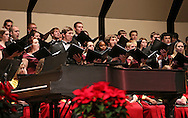 "The Coe College Concert Choir performs ""The Word Was God"" during the Coe College Christmas Convocation at Sinclair Auditorium in Cedar Rapids on December 3, 2013. The convocation included songs by the Coe College Chorale, Concert Choir, and Handbell Ensemble, along with readings from the Bible."