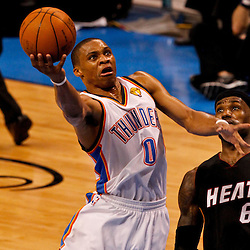 Jun 14, 2012; Oklahoma City, OK, USA; Oklahoma City Thunder point guard Russell Westbrook (0) shoots over Miami Heat small forward LeBron James (6) during the fourth quarter of game two in the 2012 NBA Finals at Chesapeake Energy Arena. Mandatory Credit: Derick E. Hingle-US PRESSWIRE