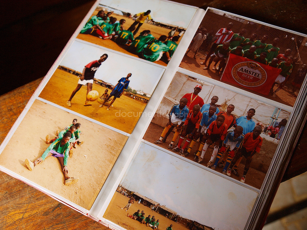 The photo album of Sunny Boy, the coach of the Young Stars of Kroo Bay, Kroo Bay, Freetown, Sierra Leone